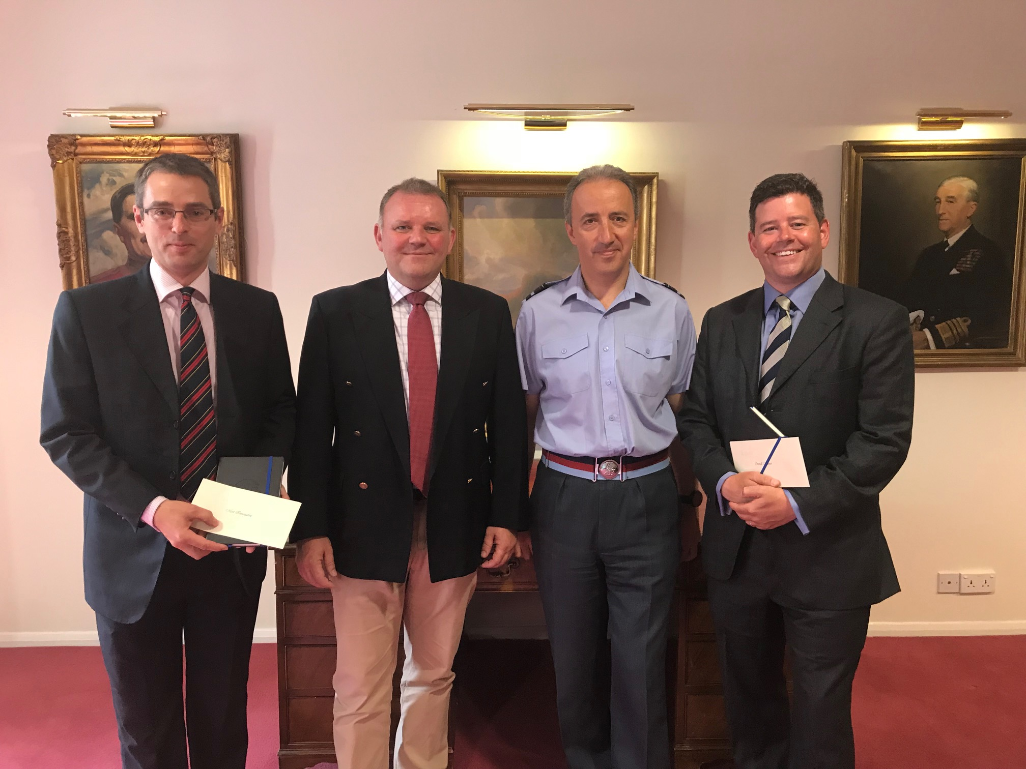 AVM Luck (Comdt JSCSC) and Carl Gorton (Dep Hd Training NSC) awarding prizes to Ant Sharman (best overall essay) and Andy Bell (most innovative) on 19 Jul 18.