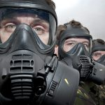 Military personnel in gas masks