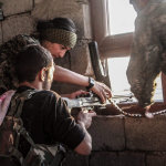 3 fighters in a window in an Urban warfare setting